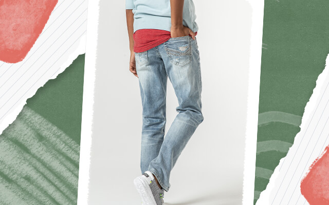 A boy wearing a pair of light wash jeans.