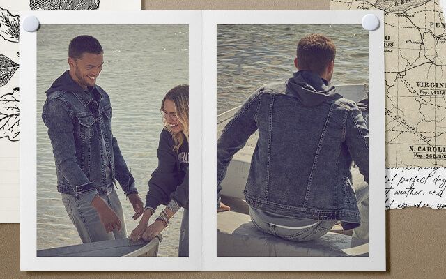 A guy in a row boat wearing a hooded sweatshirt with a dark denim jacket and light wash jeans.
