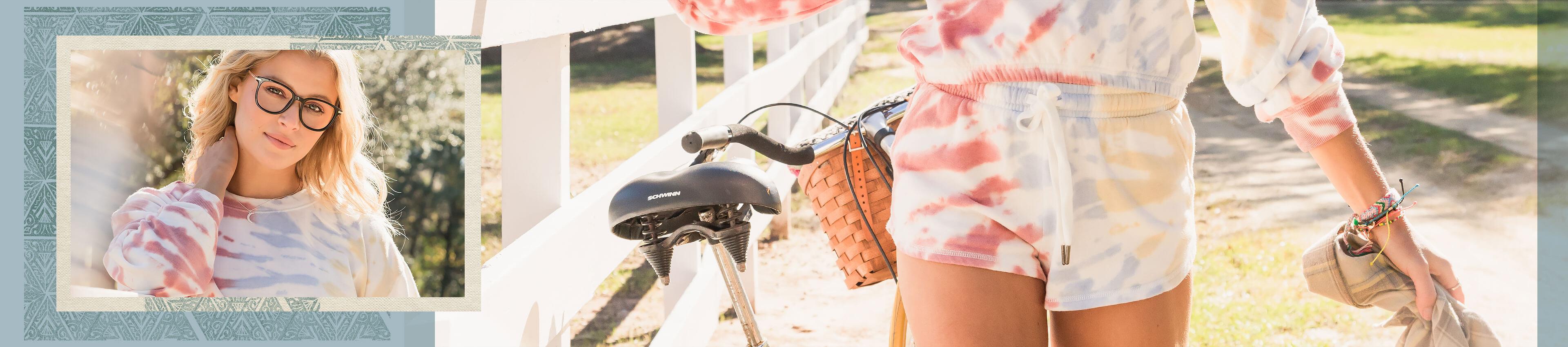 Gal wearing a matching tie dye sweatshirt and shorts