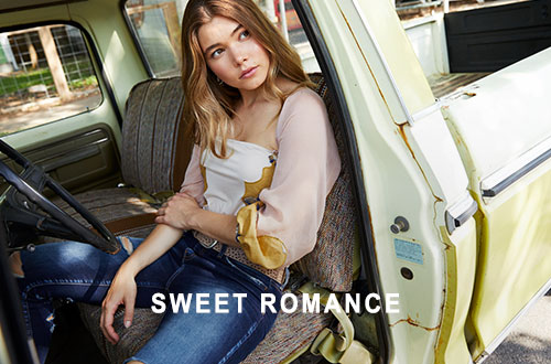 Shop Gimmicks Sweet Romance - Girl wearing a cream floral Gimmicks top with dark denim in a truck