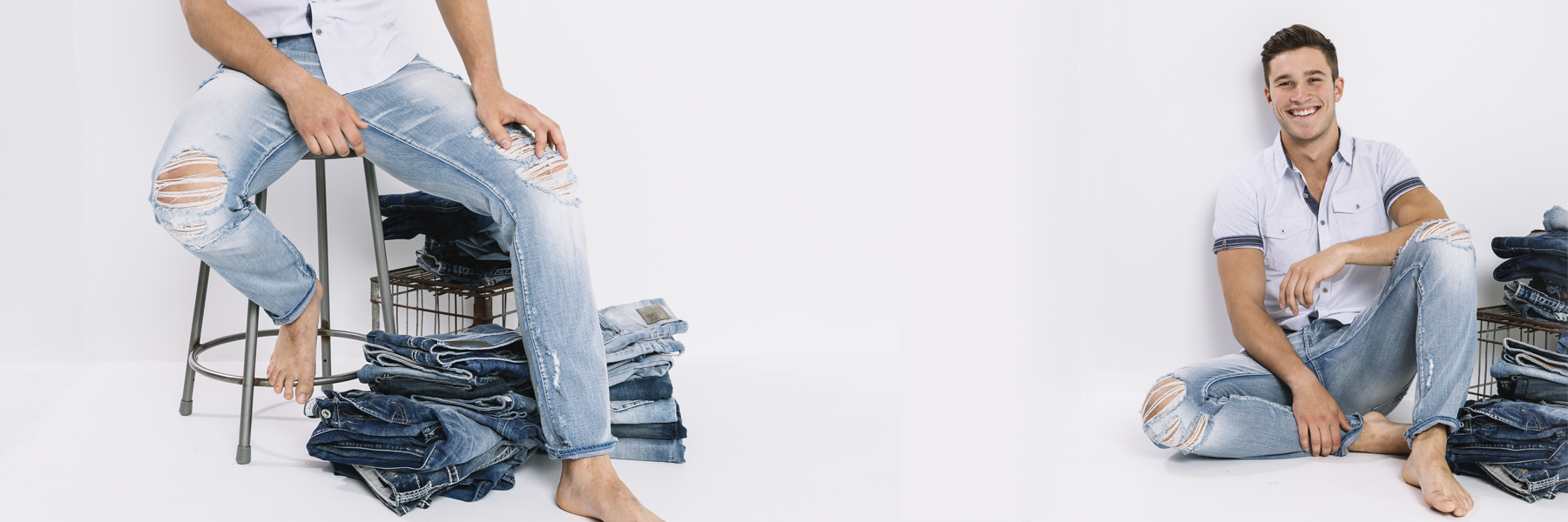 Guy sitting on stool and on floor next to piles of folded jeans.