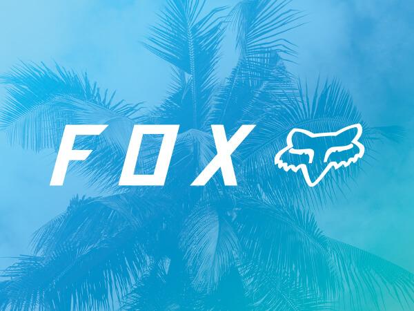 Fox logo on bright blue decorative background.