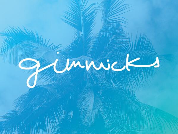 Gimmicks logo on bright blue decorative background.