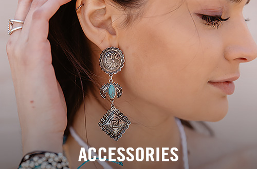 Girl wearing silver and turquoise earrings
