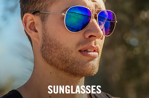 Guy wearing a pair of silver sunglasses