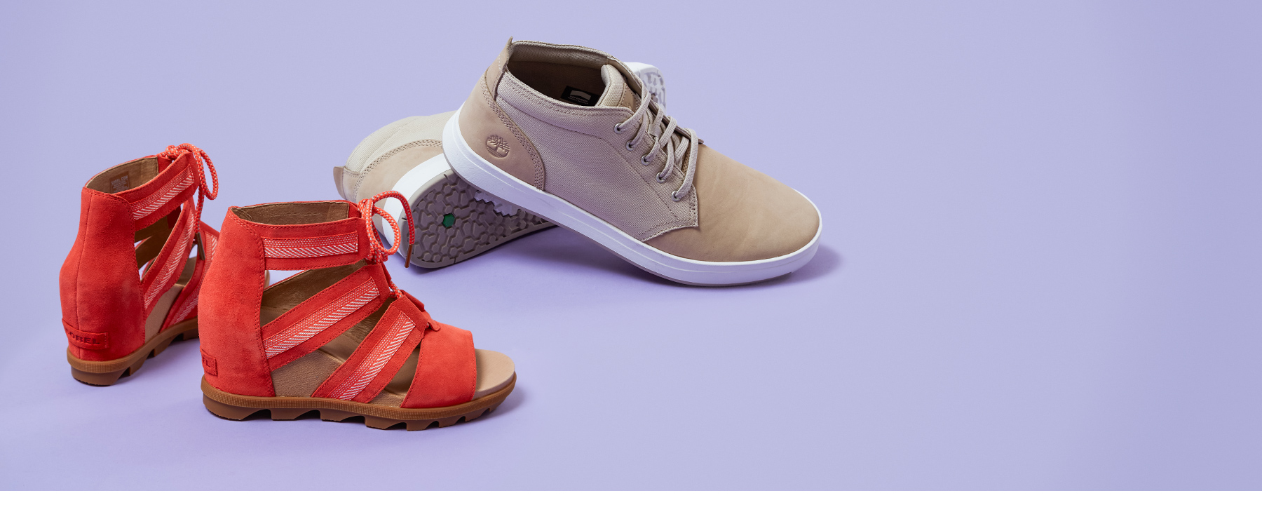 Women's red Sorel wedges and a men's cream Timberland shoe.