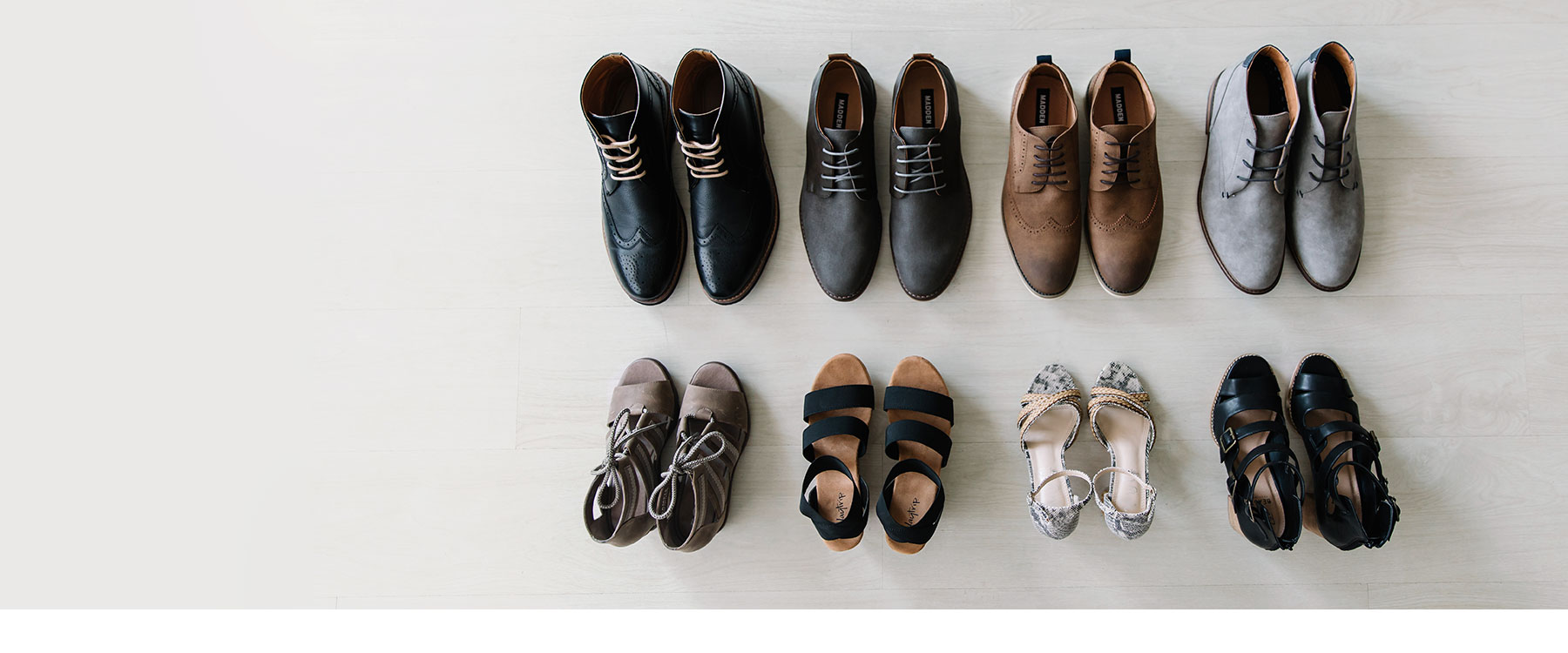 Four pairs of men's dress shoes and four pairs of women's heels