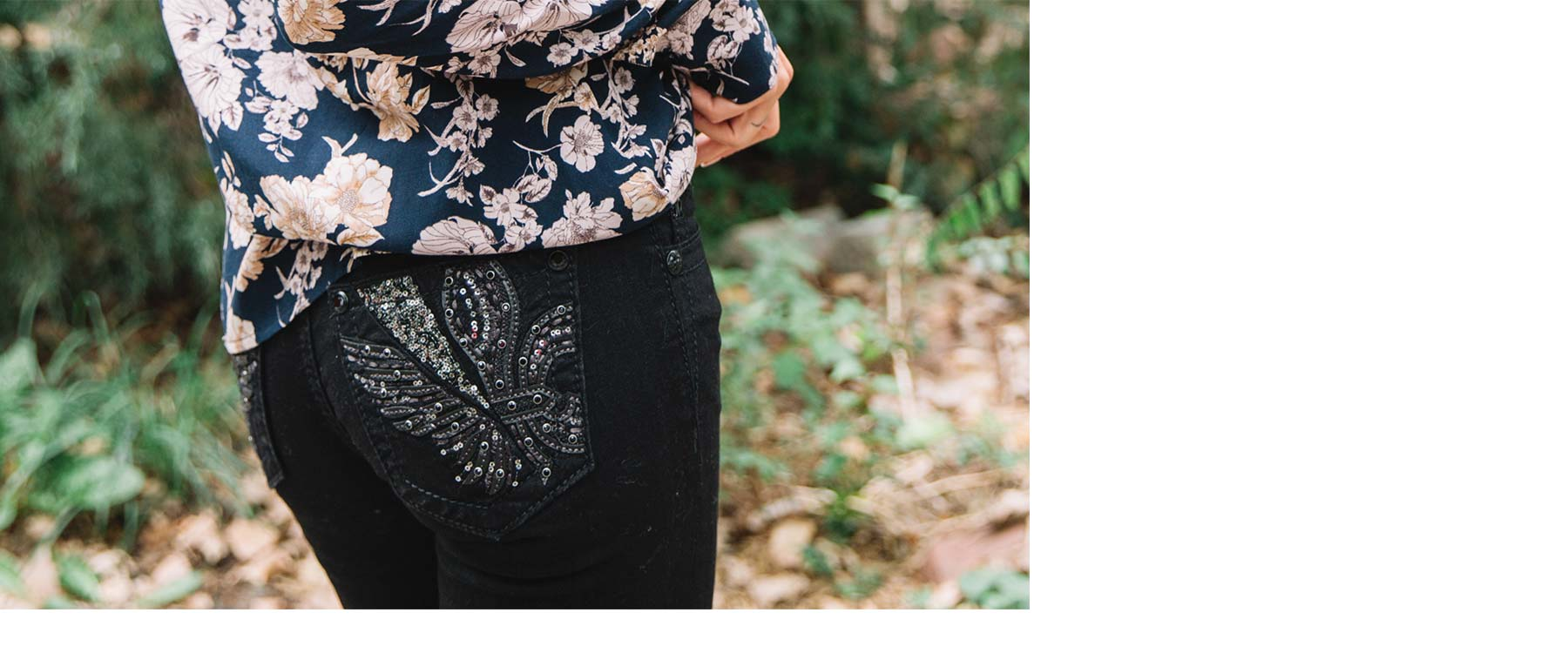 Pocket view of women's Miss Me black jeans to show rhinestone detail.