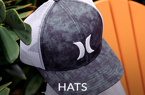 A grey and white Hurley trucker hat