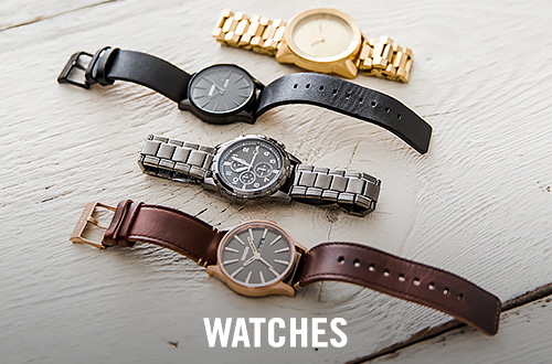A Gold, a black, a silver and a brown watch on a wooden surface