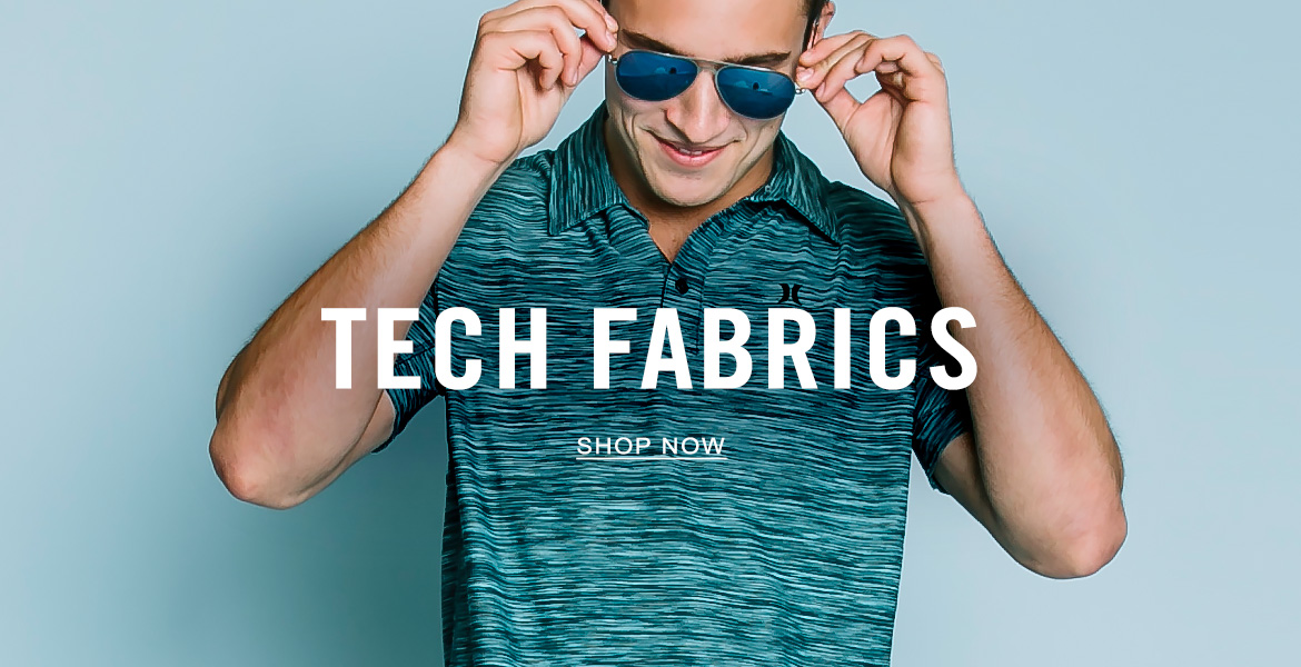Man wearing a turquoise and black tech polo
