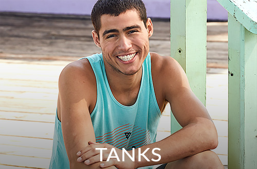 Guy wearing a turquoise graphic tank top