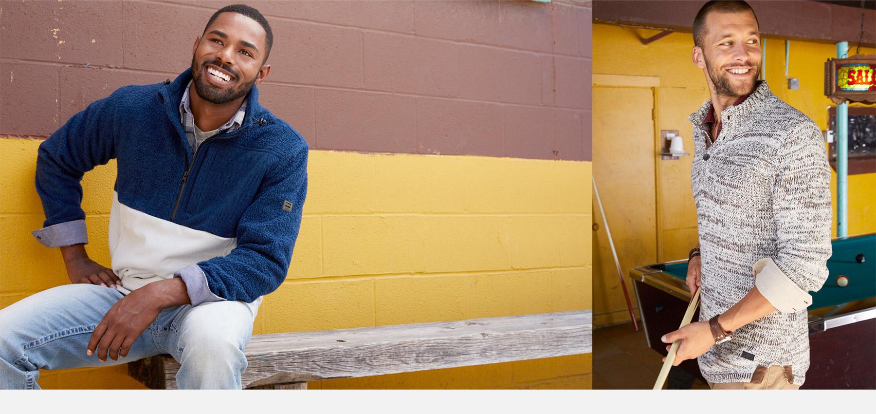 Guy wearing a blue quarter zip Billabong sweatshirt and light wash denim. Guy wearing a cream pullover sweater and khakis.