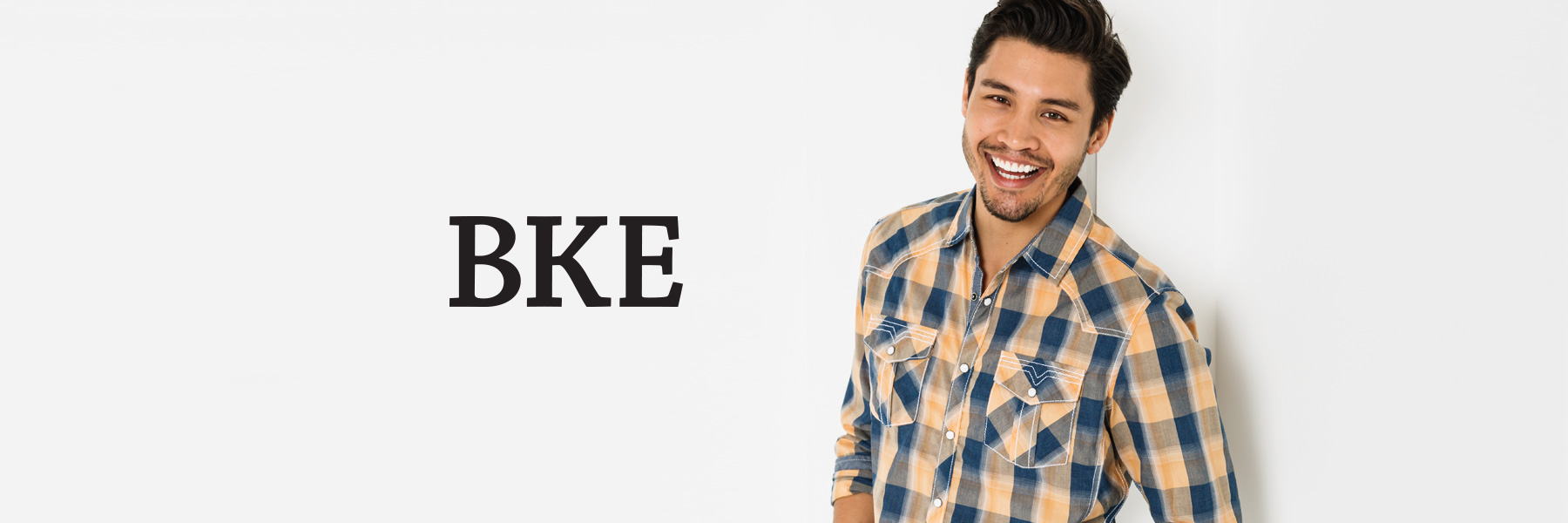 Shop Men's BKE - Guy wearing a blue and yellow plaid BKE shirt