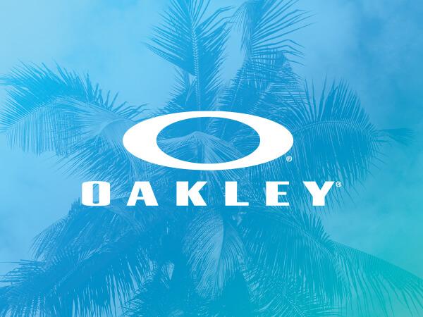 Oakley logo on bright blue decorative background.