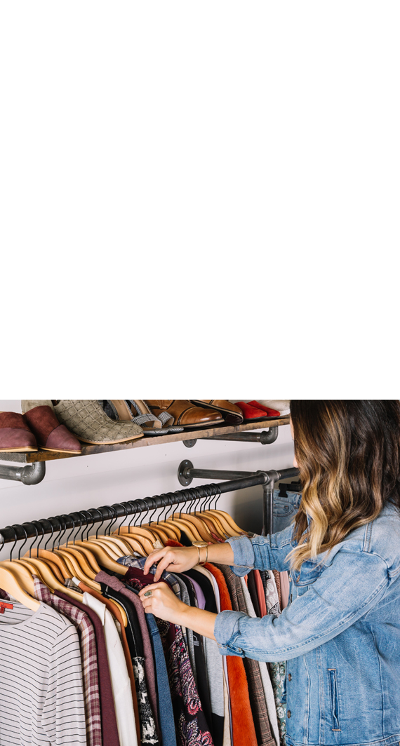 Woman looking thru Buckle clothing at a Buckle Store
