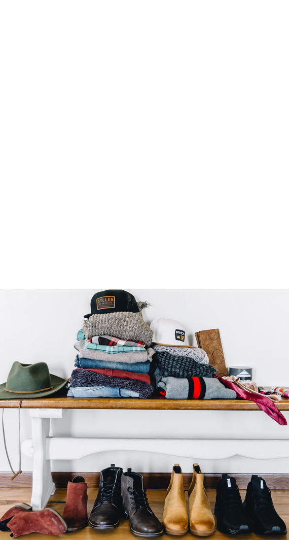 Stack of Men's and Women's Buckle clothing and accessories