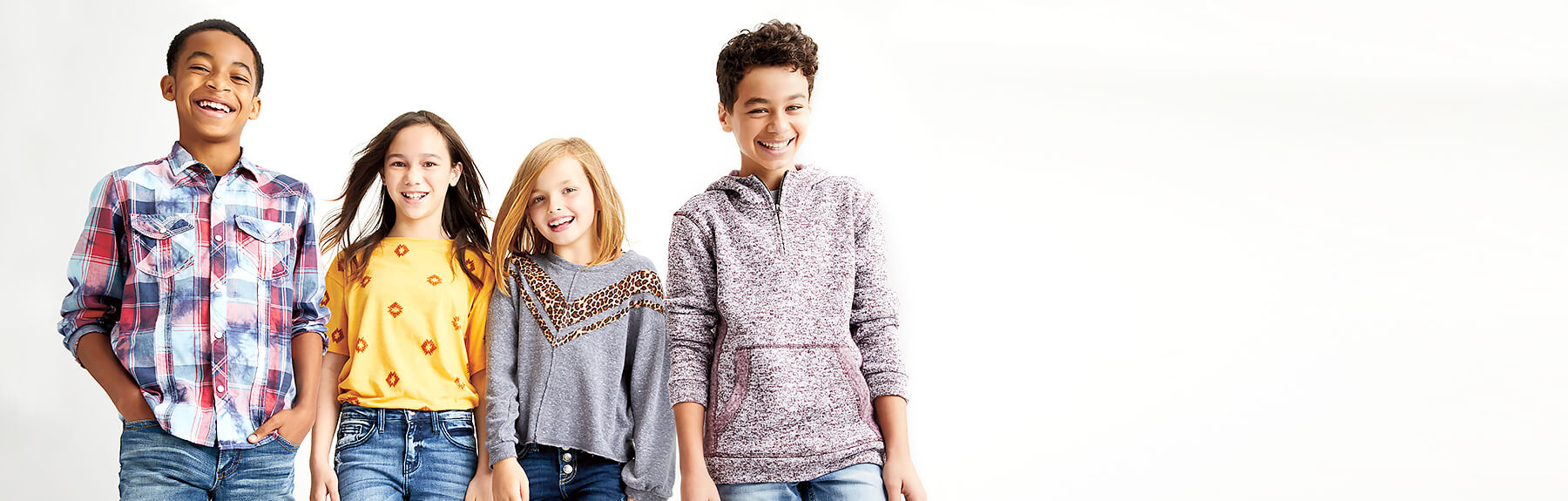 Group of kids wearing new fall clothing from Buckle.