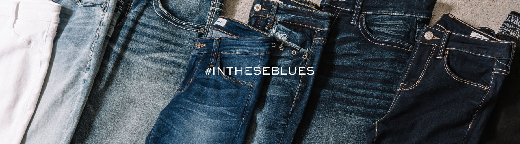 Close up view of different washes of jeans, from light to dark.