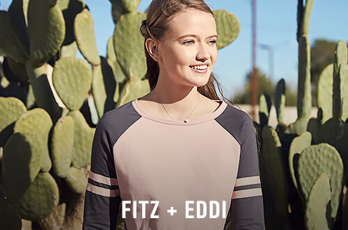 Woman wearing a pink and blue Fitz and Eddi raglan t-shirt - Shop Fitz and Eddi