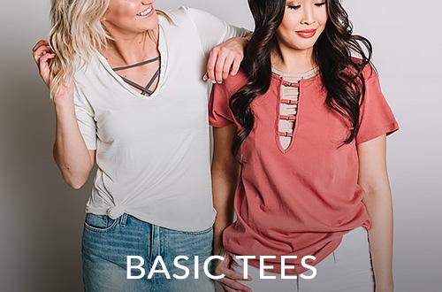 One girl wearing a cream basic tee. A girl wearing a pink basic tee