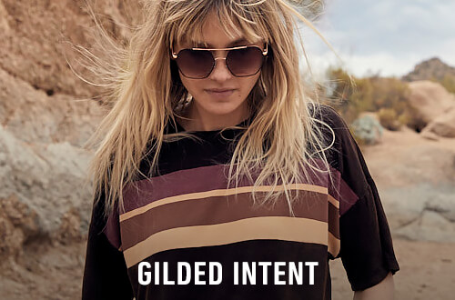 Woman wearing a Gilded Intend brown striped top with sunglasses - Shop Gilded Intent