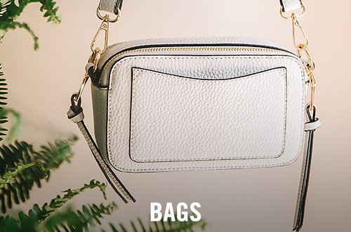 A cream colored crossbody bag
