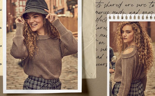 A gal wearing a brown BKE cold shoulder sweater and a grey bucket hat