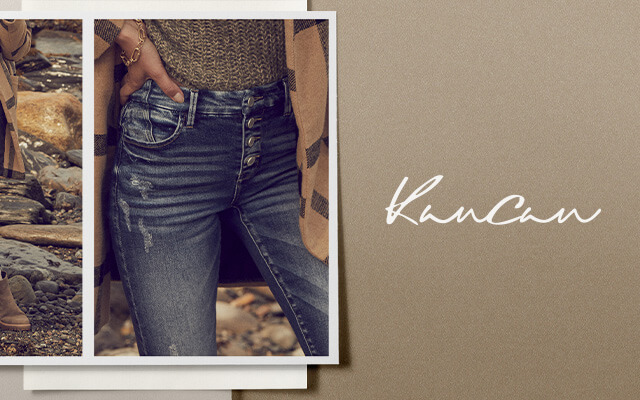 A gal wearing a pair of KanCan dark wash distressed jeans