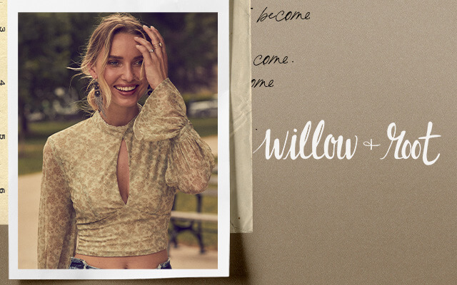 A gal wearing a cream cropped long sleeve Willow & Root top and dark wash jeans.