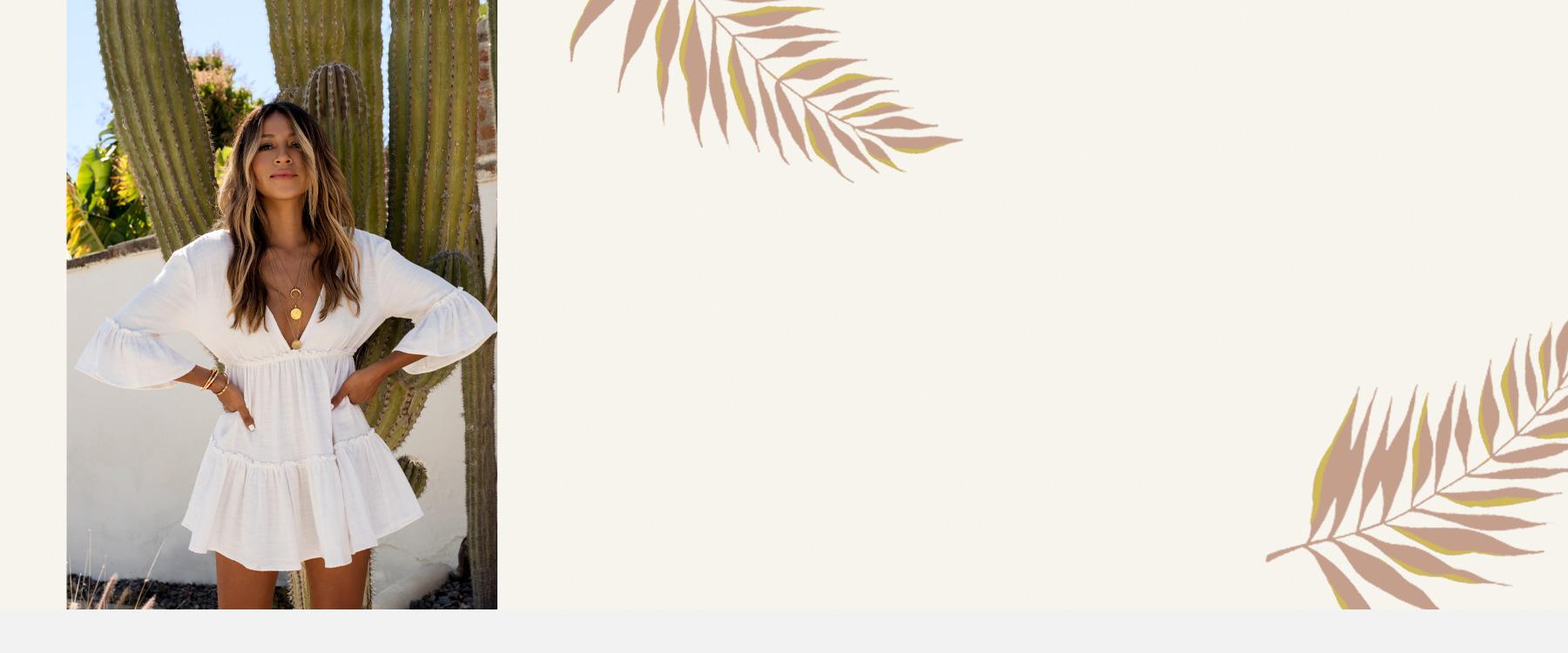 Girl wearing a white Billabong X Sincerely Jules Dress