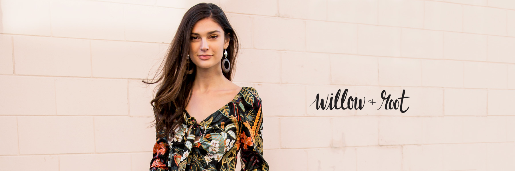 Shop Willow & Root - Girl wearing a black floral Willow & Root top